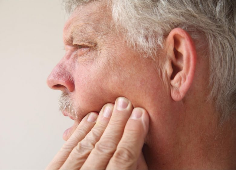 middle aged man with jaw pain on one side
