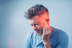 Man with Ear Ache From Tooth infection
