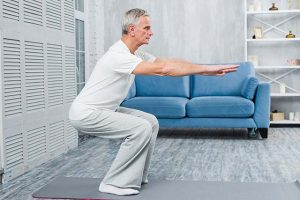 old man doing low impact exercise for knees