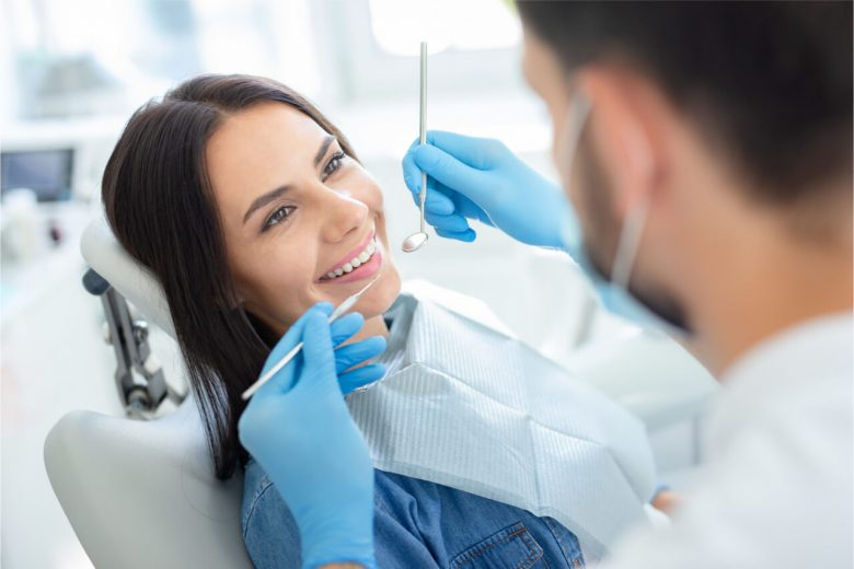 The woman is ready to receive dental treatment.